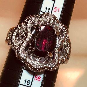 Really pretty Garnet and Silver tone Filigree Ring
